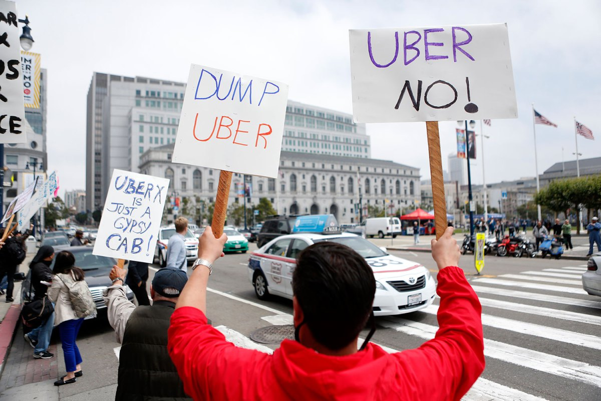 San Francisco taxi drivers show their opposition to Uber which taxi drivers say is operating illegally in San Francisco