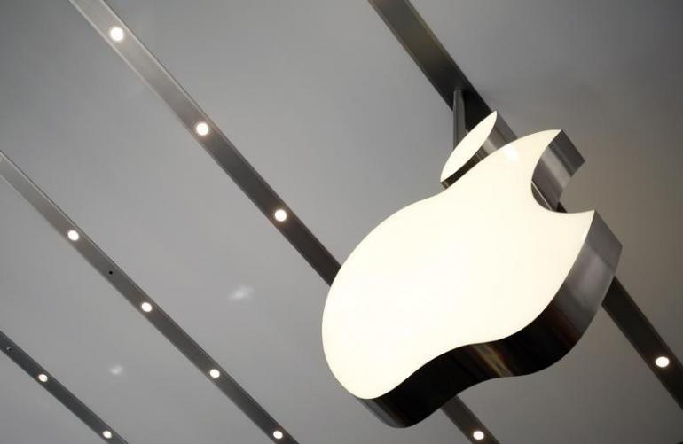 451003-apple-logo-is-pictured-inside-the-newly-opened-omotesando-apple-store-